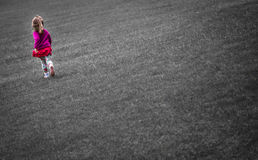 Girl running on the grass Royalty Free Stock Images