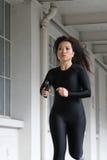 Girl running with a gun Stock Image