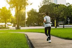 Girl running. A healthy girl running in the park at morning sky lifestyle woman beauty motion summer energy outside people runner nature outdoor workout green royalty free stock photos
