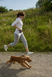Girl running with her dog