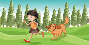 A girl running with her dog Stock Photos
