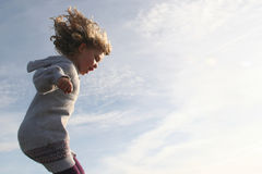 Girl running and jumping Royalty Free Stock Image