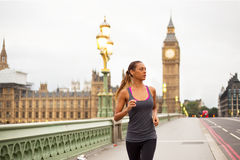 Girl running in London Stock Photo