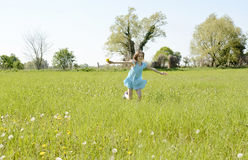 Girl running on meadow Royalty Free Stock Image