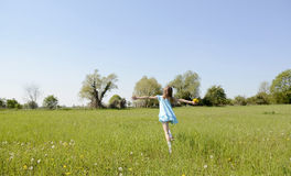 Girl running on meadow Royalty Free Stock Images