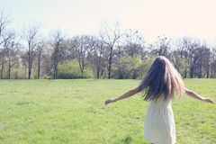 Girl running on meadow Royalty Free Stock Photography