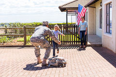 Girl running military father. Excited little girl running to her military father royalty free stock photography