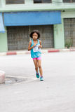 Girl is running in mini marathon Royalty Free Stock Images