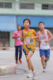 Girl is running in mini marathon Stock Images