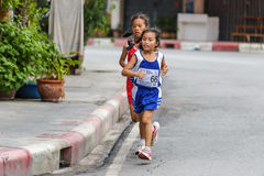 Girl is running in mini marathon Stock Photo