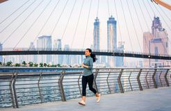 Girl running in a modern city environment royalty free stock photos