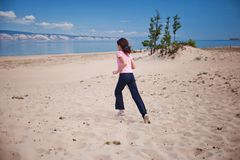 Girl Running in Olkhon Island Sand Stock Image