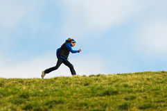 Girl Running On A Hill Royalty Free Stock Image