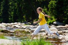 Girl running outdoor Stock Images