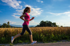 Girl running outdoor Stock Image