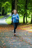 Girl running outdoor Royalty Free Stock Photography