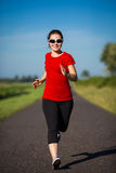 Girl running outdoor Stock Images