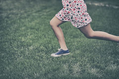 Girl running outdoors Royalty Free Stock Photos