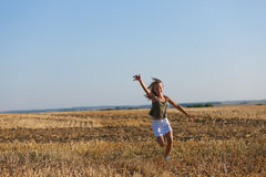 Girl running over a autumn field Royalty Free Stock Photography
