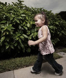 Girl running in the park Stock Image