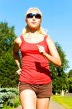 Girl running in park Royalty Free Stock Image