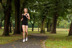 Girl running in the park Royalty Free Stock Photography