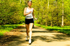 Girl running in park Stock Photography