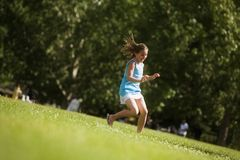 Girl Running In The Park Royalty Free Stock Image