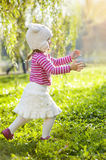 Girl running in the park Royalty Free Stock Photo