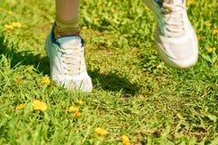 Girl running in the park Stock Photos