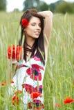 Girl running in poppy field Stock Image