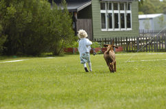 Girl running with puppy Stock Photo