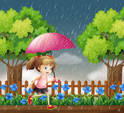 Girl running in the rain Royalty Free Stock Photography