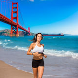 Girl running San Francisco Golden Gate Bridge Royalty Free Stock Photography