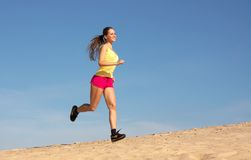 Girl running on sand Stock Photo