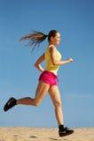Girl running on sand royalty free stock photos