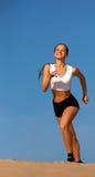 Girl running on sand stock images