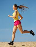 Girl running on sand stock photos