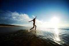 Girl running in the sea Royalty Free Stock Photography