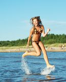 Girl running in the sea Royalty Free Stock Images