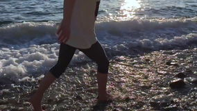 Girl running at the sea shore in slo motion on a sunny day stock video footage