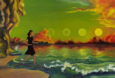 Girl running in the sea. At sunset from the four suns Royalty Free Stock Image