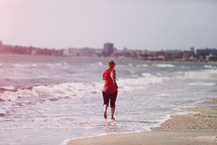 Girl running on the shore Royalty Free Stock Photos