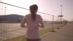 The girl is running. Slow motion Football arena of the Olympic Park in the city of Sochi stock video footage