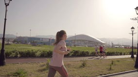 The girl is running. Slow motion football arena of the Olympic Park in the city of Sochi. Football arena of the Olympic Park in the city of Sochi stock video