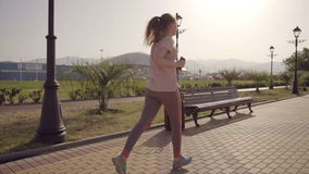 The girl is running. Slow motion football arena of the olympic park in the city of Sochi stock video