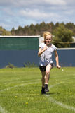 Girl running in sports race stock image