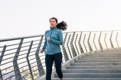 Girl running on the staircase outdoors royalty free stock photo