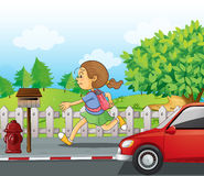 A girl running in the street Stock Photography