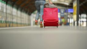 Girl Running with a suitcase in a train station stock footage